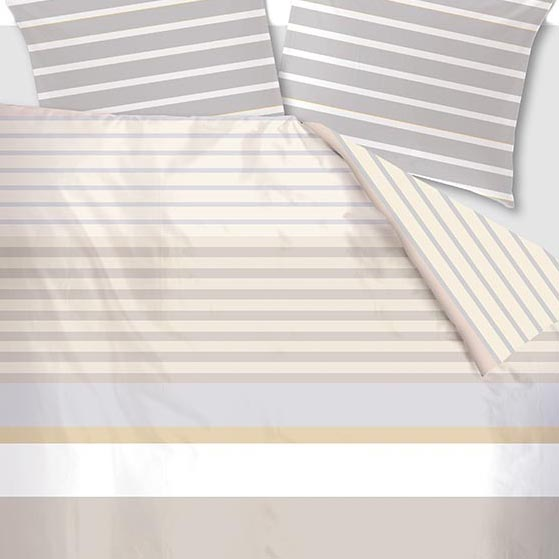 Infinity duvet cover sand on an Auping bed